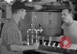 Image of United States Navy sailors enjoy ice cream Pacific Ocean, 1954, second 17 stock footage video 65675051350