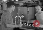 Image of United States Navy sailors enjoy ice cream Pacific Ocean, 1954, second 18 stock footage video 65675051350