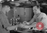 Image of United States Navy sailors enjoy ice cream Pacific Ocean, 1954, second 22 stock footage video 65675051350