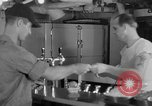 Image of United States Navy sailors enjoy ice cream Pacific Ocean, 1954, second 23 stock footage video 65675051350