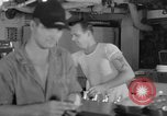 Image of United States Navy sailors enjoy ice cream Pacific Ocean, 1954, second 25 stock footage video 65675051350