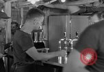 Image of United States Navy sailors enjoy ice cream Pacific Ocean, 1954, second 32 stock footage video 65675051350