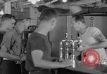 Image of United States Navy sailors enjoy ice cream Pacific Ocean, 1954, second 35 stock footage video 65675051350
