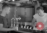 Image of United States Navy sailors enjoy ice cream Pacific Ocean, 1954, second 38 stock footage video 65675051350