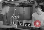 Image of United States Navy sailors enjoy ice cream Pacific Ocean, 1954, second 39 stock footage video 65675051350