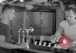 Image of United States Navy sailors enjoy ice cream Pacific Ocean, 1954, second 40 stock footage video 65675051350
