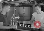 Image of United States Navy sailors enjoy ice cream Pacific Ocean, 1954, second 42 stock footage video 65675051350