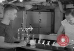 Image of United States Navy sailors enjoy ice cream Pacific Ocean, 1954, second 46 stock footage video 65675051350