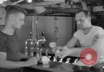 Image of United States Navy sailors enjoy ice cream Pacific Ocean, 1954, second 49 stock footage video 65675051350