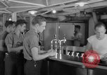 Image of United States Navy sailors enjoy ice cream Pacific Ocean, 1954, second 56 stock footage video 65675051350