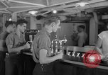 Image of United States Navy sailors enjoy ice cream Pacific Ocean, 1954, second 57 stock footage video 65675051350