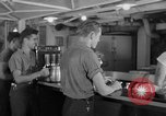 Image of United States Navy sailors enjoy ice cream Pacific Ocean, 1954, second 58 stock footage video 65675051350