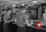 Image of United States Navy sailors enjoy ice cream Pacific Ocean, 1954, second 59 stock footage video 65675051350