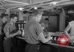 Image of United States Navy sailors enjoy ice cream Pacific Ocean, 1954, second 60 stock footage video 65675051350