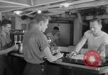 Image of United States Navy sailors enjoy ice cream Pacific Ocean, 1954, second 61 stock footage video 65675051350