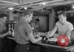 Image of United States Navy sailors enjoy ice cream Pacific Ocean, 1954, second 62 stock footage video 65675051350