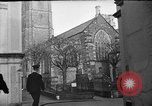 Image of United States Coast Guard personnel march in formation to Sunday service at a church England United Kingdom, 1944, second 13 stock footage video 65675051454