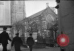 Image of United States Coast Guard personnel march in formation to Sunday service at a church England United Kingdom, 1944, second 14 stock footage video 65675051454