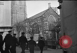 Image of United States Coast Guard personnel march in formation to Sunday service at a church England United Kingdom, 1944, second 15 stock footage video 65675051454