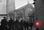 Image of United States Coast Guard personnel march in formation to Sunday service at a church England United Kingdom, 1944, second 17 stock footage video 65675051454