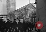 Image of United States Coast Guard personnel march in formation to Sunday service at a church England United Kingdom, 1944, second 18 stock footage video 65675051454