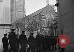 Image of United States Coast Guard personnel march in formation to Sunday service at a church England United Kingdom, 1944, second 20 stock footage video 65675051454