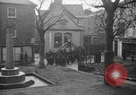 Image of United States Coast Guard personnel march in formation to Sunday service at a church England United Kingdom, 1944, second 21 stock footage video 65675051454