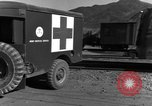 Image of United States soldiers evacuating wounded Korea, 1954, second 28 stock footage video 65675051535