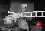 Image of preparation of dough nuts Uijongbu South Korea, 1954, second 7 stock footage video 65675051545