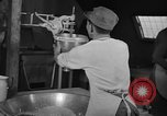 Image of preparation of dough nuts Uijongbu South Korea, 1954, second 14 stock footage video 65675051545