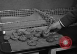Image of preparation of dough nuts Uijongbu South Korea, 1954, second 29 stock footage video 65675051545