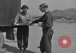 Image of preparation of dough nuts Uijongbu South Korea, 1954, second 36 stock footage video 65675051545