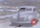 Image of Advertisement for smooth ride of 1939 Ford automobiles United States USA, 1939, second 13 stock footage video 65675051551