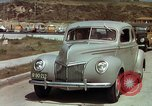 Image of Advertisement for smooth ride of 1939 Ford automobiles United States USA, 1939, second 14 stock footage video 65675051551