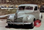 Image of Advertisement for smooth ride of 1939 Ford automobiles United States USA, 1939, second 15 stock footage video 65675051551
