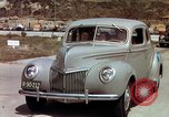 Image of Advertisement for smooth ride of 1939 Ford automobiles United States USA, 1939, second 16 stock footage video 65675051551