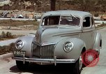 Image of Advertisement for smooth ride of 1939 Ford automobiles United States USA, 1939, second 18 stock footage video 65675051551