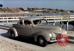 Image of Advertisement for smooth ride of 1939 Ford automobiles United States USA, 1939, second 43 stock footage video 65675051551