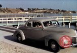 Image of Advertisement for smooth ride of 1939 Ford automobiles United States USA, 1939, second 44 stock footage video 65675051551
