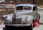 Image of Advertisement for smooth ride of 1939 Ford automobiles United States USA, 1939, second 46 stock footage video 65675051551