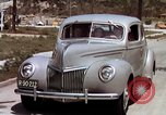 Image of Advertisement for smooth ride of 1939 Ford automobiles United States USA, 1939, second 47 stock footage video 65675051551