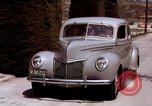 Image of Advertisement for smooth ride of 1939 Ford automobiles United States USA, 1939, second 52 stock footage video 65675051551