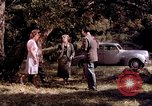 Image of People visiting a forest in their 1939 Ford car United States USA, 1939, second 25 stock footage video 65675051552