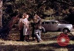 Image of People visiting a forest in their 1939 Ford car United States USA, 1939, second 26 stock footage video 65675051552