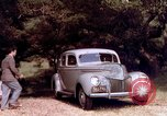 Image of People visiting a forest in their 1939 Ford car United States USA, 1939, second 31 stock footage video 65675051552