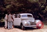 Image of People visiting a forest in their 1939 Ford car United States USA, 1939, second 33 stock footage video 65675051552