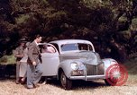 Image of People visiting a forest in their 1939 Ford car United States USA, 1939, second 34 stock footage video 65675051552
