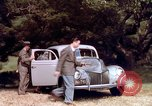 Image of People visiting a forest in their 1939 Ford car United States USA, 1939, second 35 stock footage video 65675051552