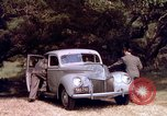 Image of People visiting a forest in their 1939 Ford car United States USA, 1939, second 37 stock footage video 65675051552
