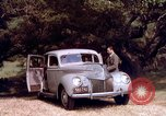 Image of People visiting a forest in their 1939 Ford car United States USA, 1939, second 38 stock footage video 65675051552